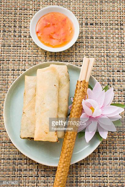 Three spring rolls and chili dip