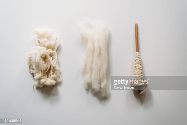 three stages: uncombed wool, combed wool and yarn - raw food stock pictures, royalty-free photos & images