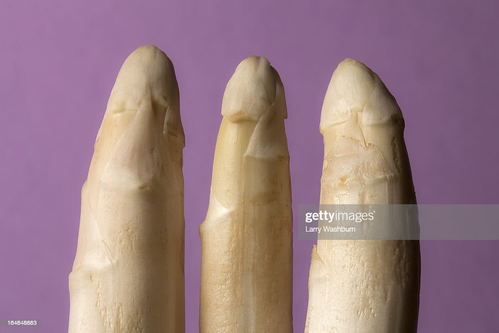 Three stalks of white asparagus suggestive of three penises : Stock Photo