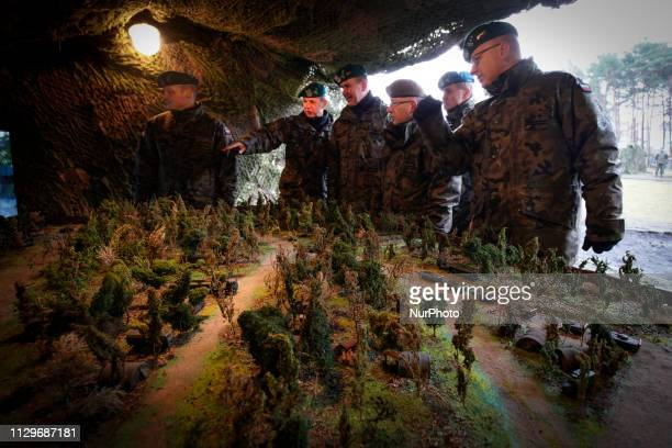 A three star general visits an exhibit at a military base in Bydgoszcz Poland on March 9 2019 The local military base organized a public picnic on...