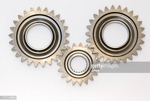 Three steel automobile gears isolated