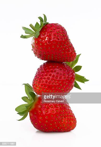 three strawberries in a stack, on white background - strawberry stock pictures, royalty-free photos & images