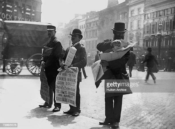Three street vendors selling newspapers and comic books in an American city June 1893 The comics on sale include Snap Shots and Chums and the...