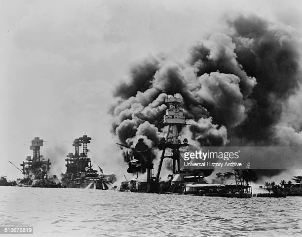 Three stricken US battleships Left to right West Virginia Tennessee and Arizona after the Japanese attack on Pearl Harbour in World War II 1941