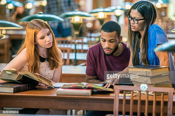 Three students in a public library