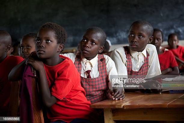 Three students stare intently ahead in a classroom full of girls at the Enkakenya Center for Excellence, a new boarding school in Western Kenya....