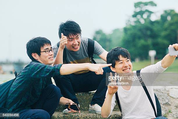 Three students taking a selfie