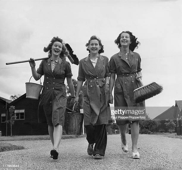 Three students working as cleaners at the Olympic village in Richmond, Surrey, during the London Olympics, July 1948. Left to right: Hilary Jones,...