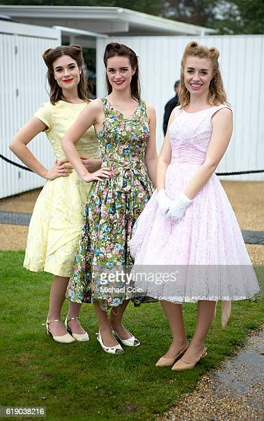 Three stylish young ladies wearing period dresses and sporting period hairstyles at Goodwood on September 10 2016 in Chichester England