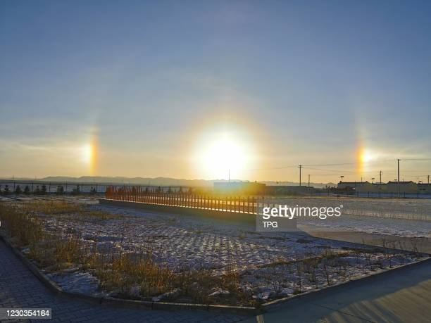 Three suns show in sky on 30th December, 2020 in Baotou,Inner Mongolia,China