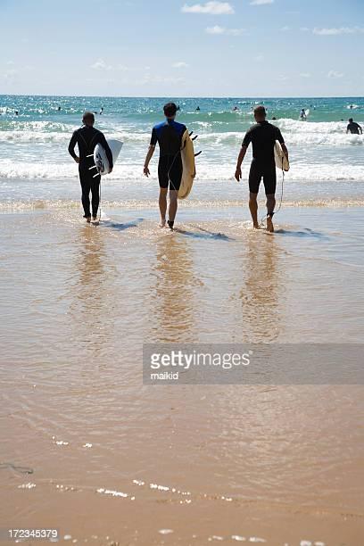 three surfer