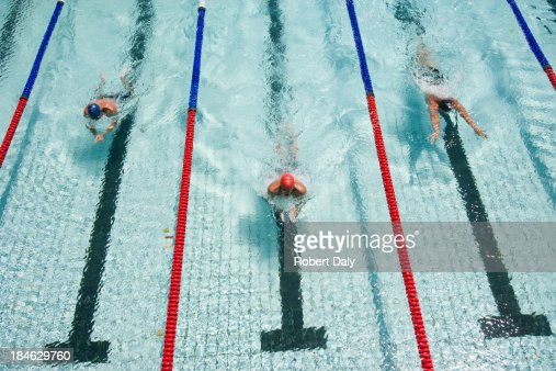 Three swimmers swimming in a pool