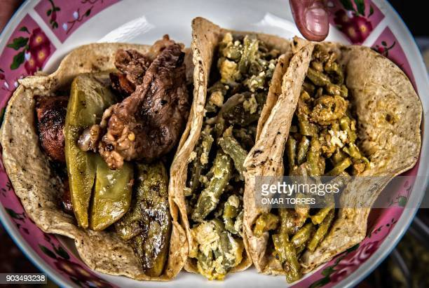 Three tacos of prickly pear or nopal cactus leaves cooked with chicken gizzards pork sausage and eggs and beef are served after the leaves were...