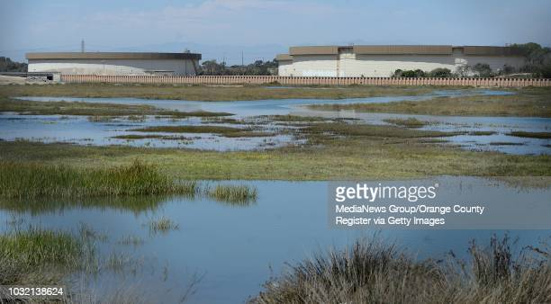 Three tanks with floating roofs sit west of Magnolia Avenue north of the Huntington Beach Wetlands on August 22, 2016. The area is the site of a...