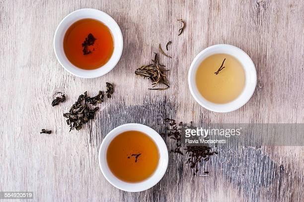 Three tea bowls of white, oolong and black tea