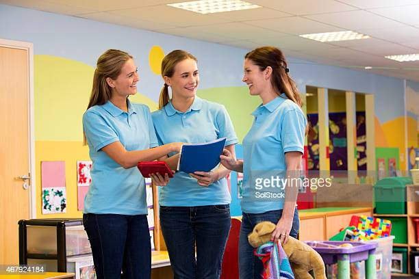 three teachers in a nursery classroom in discussion - preschool building stock pictures, royalty-free photos & images