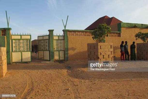 Three teen migrants stand outside a compound in Agadez Niger on December 5 2017