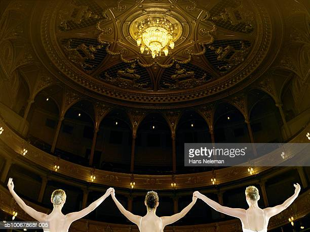 three teenage ballet dancers (13-15) on stage, rear view - theatrical performance photos et images de collection
