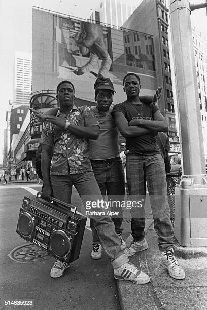 Three teenage boys pose together in Times Square New York City USA 1987
