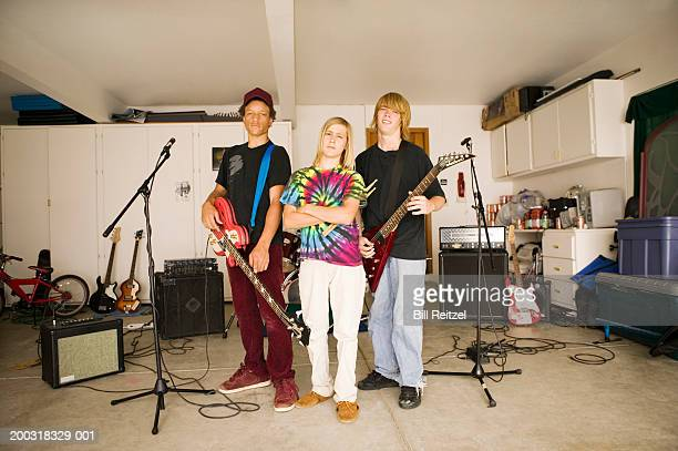 Three teenage boys (13-15) with musical instruments, portrait