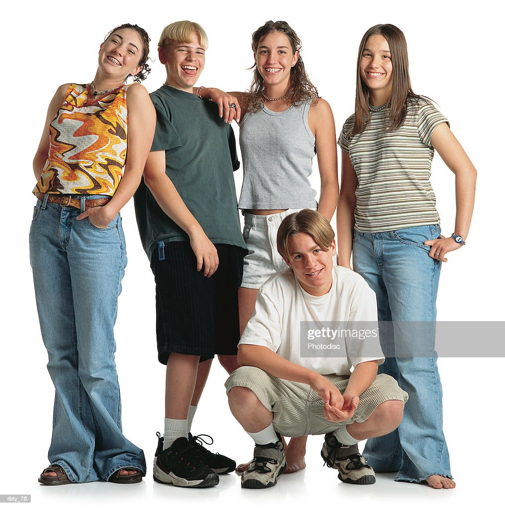 three teenage girls and two boys casually dressed gather together : Stockfoto