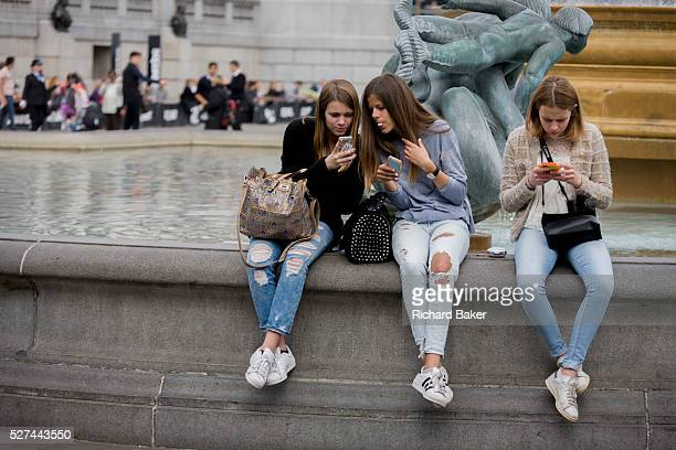 Three teenage girls are lost in the world of smartphone apps and messaging, in Trafalgar Square. While in a very busy environment, the capital's main...