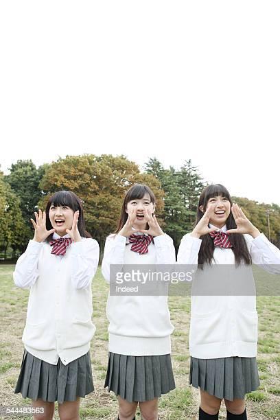 three teenage girls making a pose