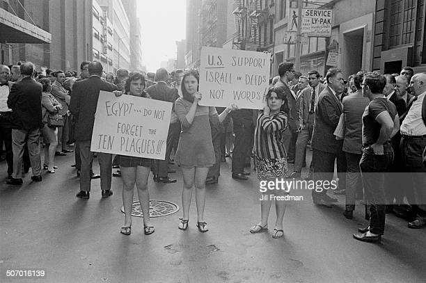 Three teenage girls show their support for Israel during the Six Day War at a demonstration in Midtown Manhattan New York City USA 1967
