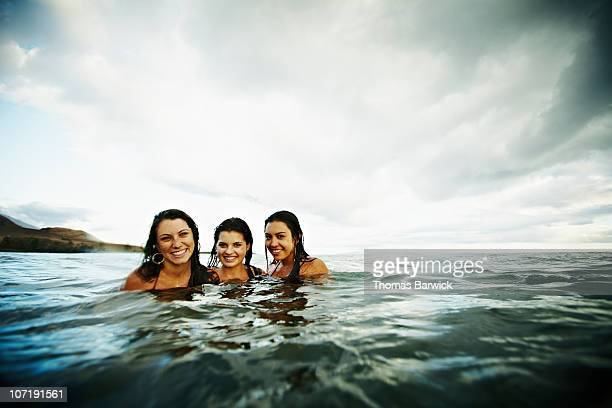Three teenage girls together in ocean