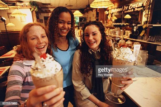 Three Teenage Girls with Milk Shakes