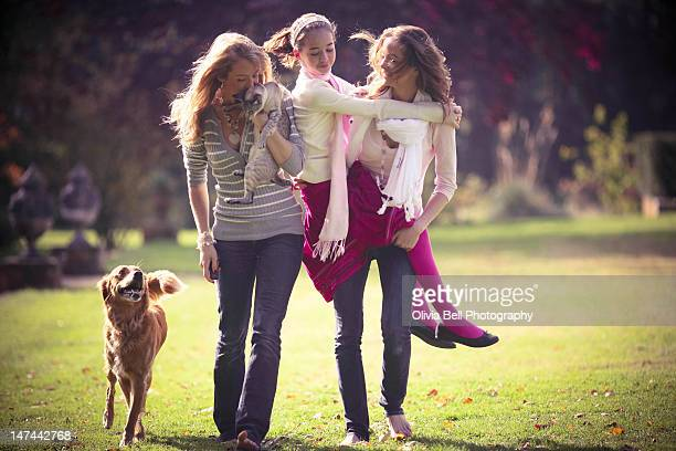 Three teenage sisters walking together