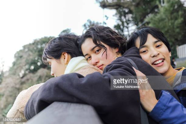 three teenagers flirting with each other. - yusuke nishizawa stock pictures, royalty-free photos & images