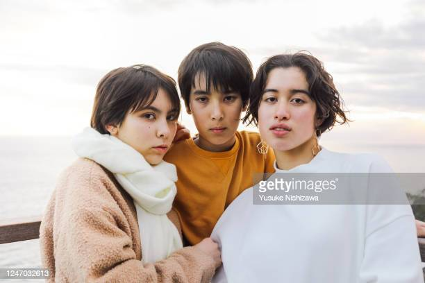 three teenagers looking at the camera. - yusuke nishizawa stock pictures, royalty-free photos & images