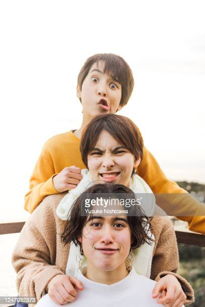 three teenagers making funny faces and playing around - yusuke nishizawa stock pictures, royalty-free photos & images
