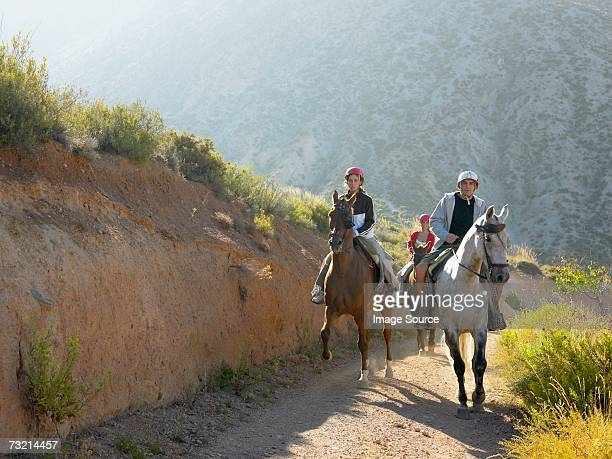 three teenagers riding horses - andalucia stock pictures, royalty-free photos & images