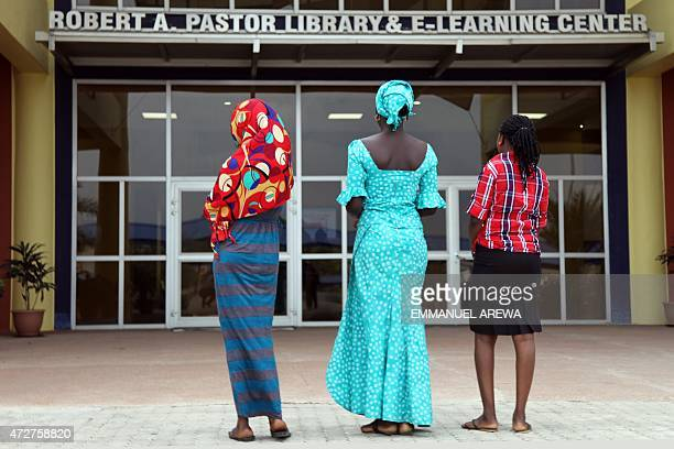 Three teenagers who escaped a Boko Haram mass kidnapping in the northeast Nigerian town of Chibok last year are seen at the American University of...