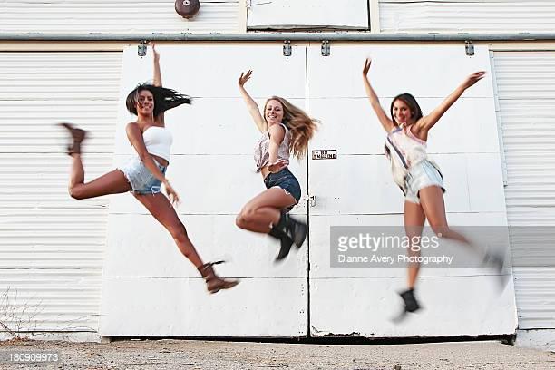 Three teens jumping