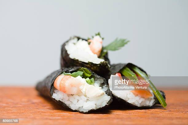 Three temaki sushi, stacked, close-up