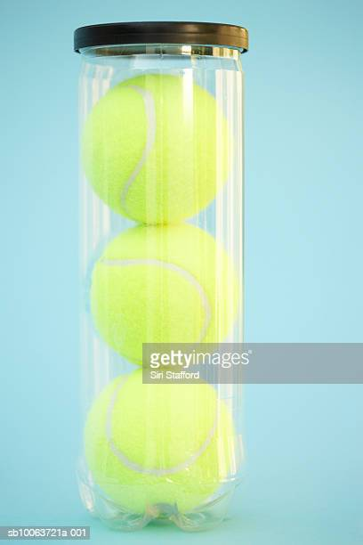 Three tennis balls in canister