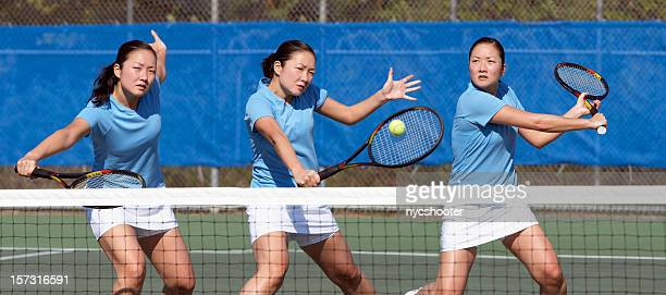 three tennis players in blue practicing - match point scoring stock pictures, royalty-free photos & images