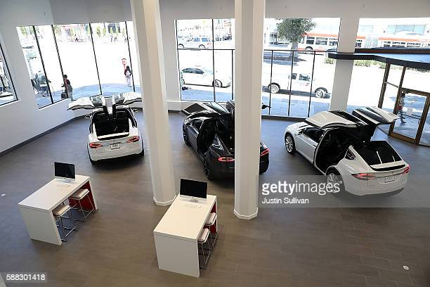 Three Tesla Model X's are displayed inside of the new Tesla flagship facility on August 10 2016 in San Francisco California Tesla is opening a 65000...