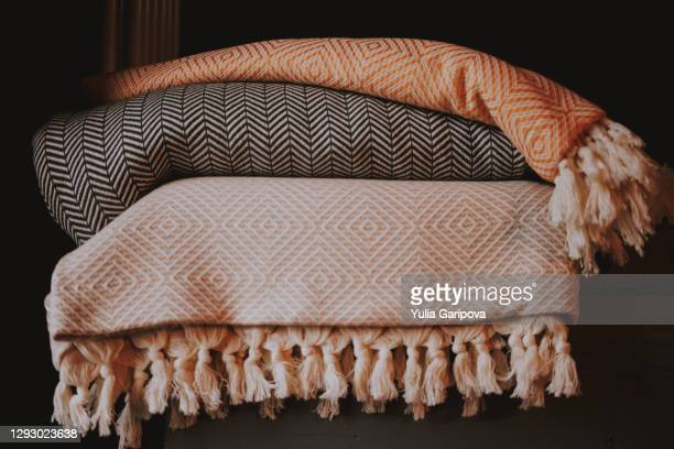 three textured cotton bedspreads in scandinavian style. - blanket stock pictures, royalty-free photos & images