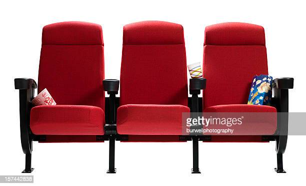 three theater seats with popcorn bags, isolated - chair stock pictures, royalty-free photos & images