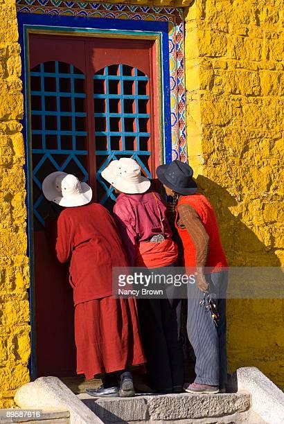 Three Tibetan pilgrims in Lasha Tibet.