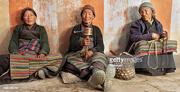 Three Tibetan women praying