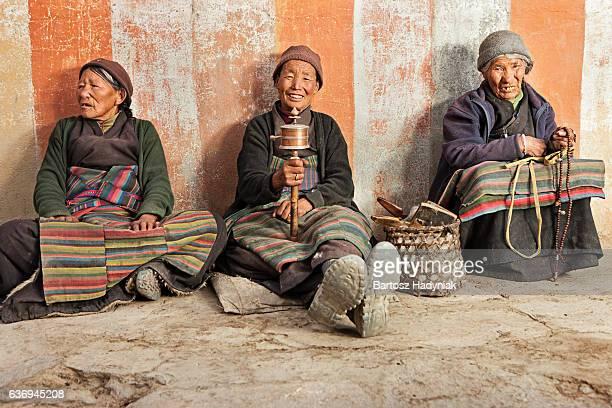 three tibetan women praying - lo manthang stock pictures, royalty-free photos & images