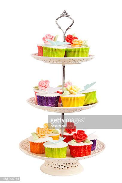 Three tiered cupcake server with cupcakes on it