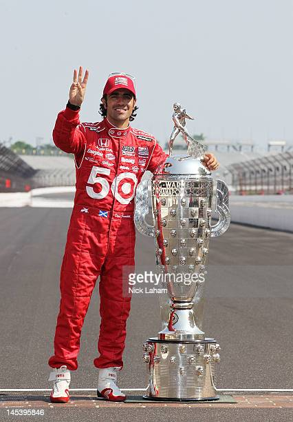 Three time Indy 500 winner Dario Franchitti of Scotland driver of the Target Chip Ganassi Racing Honda poses with the Borg Warner Trophy on the yard...