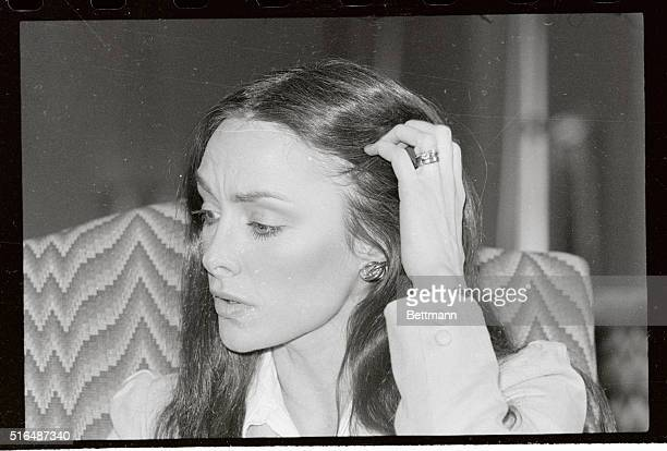 Three time Olympic Gold Medal winner Peggy Fleming is shown brushing away a lock of her while meeting with the media She descried the planned...