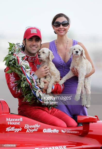 Three time winner Dario Franchitti of Scotland driver of the Target Chip Ganassi Racing Honda poses with wife Ashley Judd and their dogs on the yard...